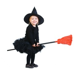 Adorable little witch flying on broomstick isolated on white