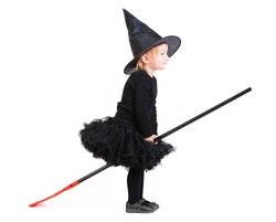 Adorable little witch on broomstick isolated on white