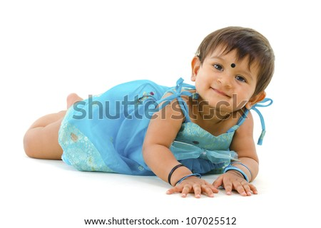 ... months old Indian baby girl lying over white background - stock photo