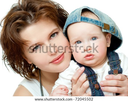 Adorable mother and daughter on a white background