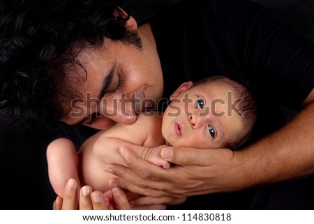 Adorable newborn baby boy with loving father