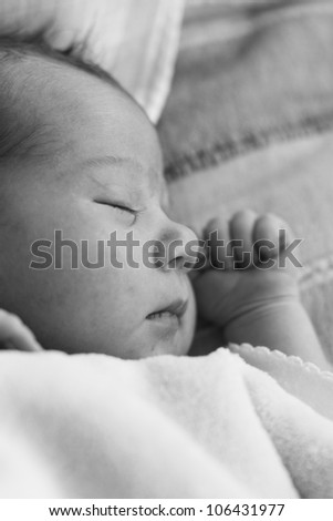 Adorable newborn baby girl portrait sleeping.
