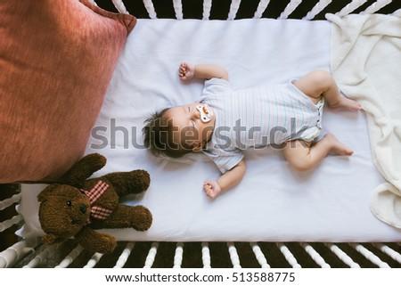 Adorable newborn lies in the crib Foto stock ©