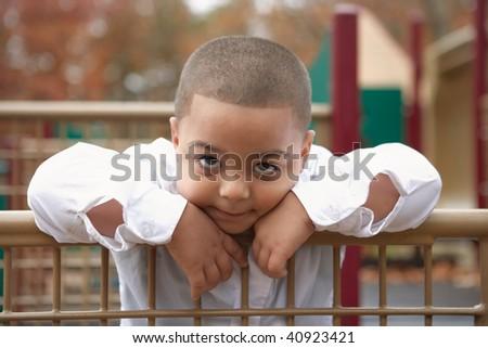 Adorable preschool hispanic boy school playground portrait