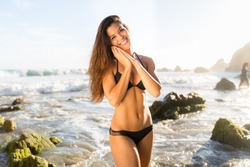 Adorable pretty beautiful smiling mixed race asian model woman beach swimsuit vacation enjoying fit toned body athletic strong