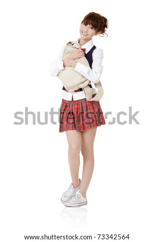 Adorable school student girl of Asian carry schoolbag, full length portrait isolated on white background.