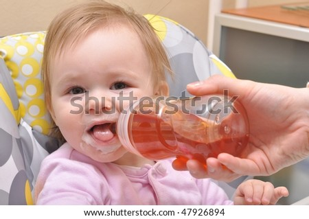 Adorable Seven month Baby eating from bottle