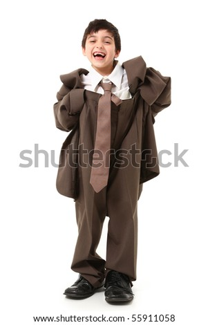 Adorable seven year old french american boy in over sized suit.