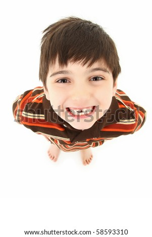 Adorable seven year old french american boy smiling up towards camera over white background.
