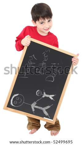 Adorable six year old boy with chalkboard displaying Happy Father's Day drawing in chalk.