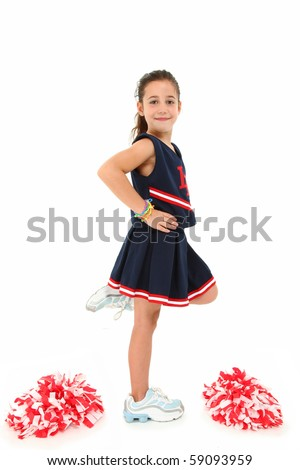 Adorable six year old euro-american girl cheerleader over white with pompoms in uniform.