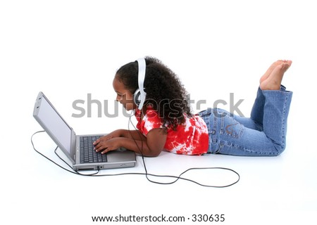 Adorable Six Year Old Girl Sitting On Floor With Laptop Computer Wearing Headphones Over White Background.