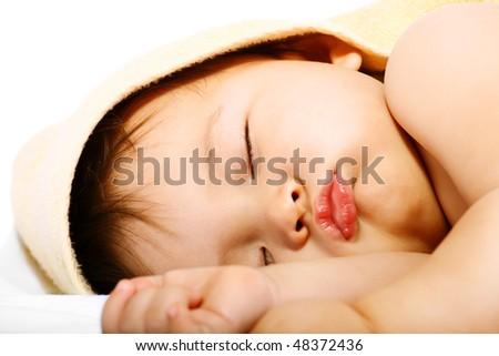 Adorable sleeping baby. Isolated on white background.