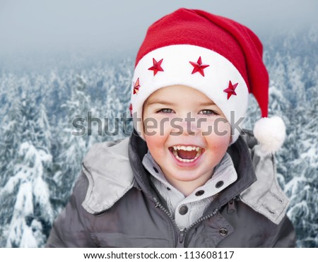 Adorable smiling child wearing Santa Claus christmas hat