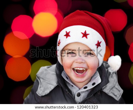 Adorable smiling child wearing Santa Claus christmas hat