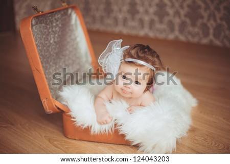 adorable smiling newborn baby girl lies in basket