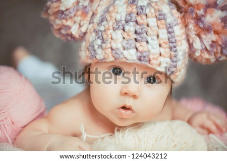 adorable smiling newborn baby girl lies in basket
