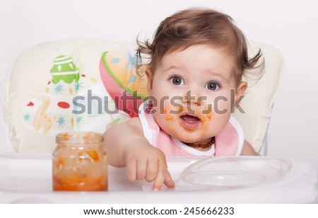Shutterstock Adorable smudgy baby and favorite food