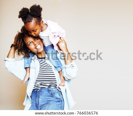 adorable sweet young afro-american mother with cute little daugh #766036576