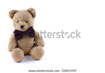 Adorable Teddy Bear with a bow tie  isolated on white - stock photo