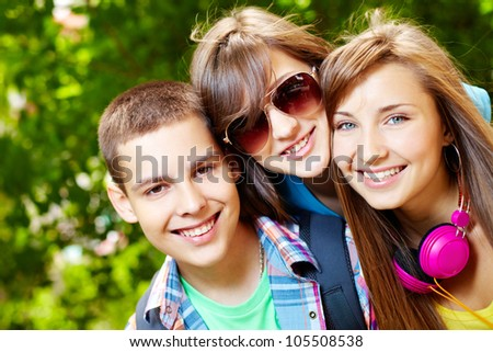 Adorable teenagers spending time outdoors in summer
