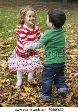 adorable toddler boy and girl dancing