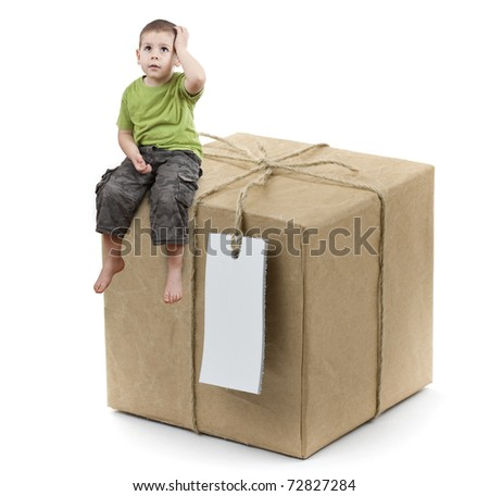 Adorable toddler boy with big gift isolated on white - stock photo