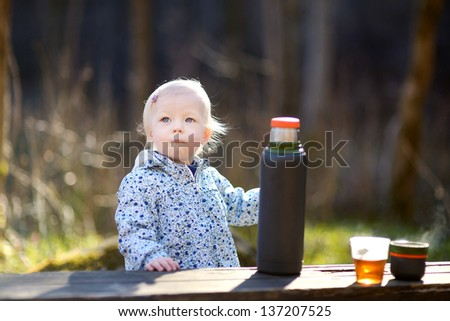 Adorable toddler girl camping in on spring