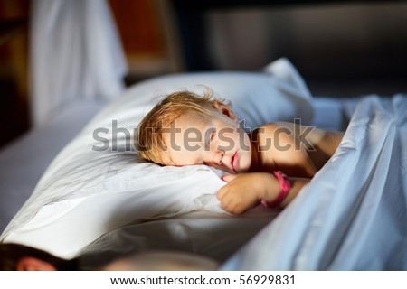 Adorable toddler girl in bedroom at the morning