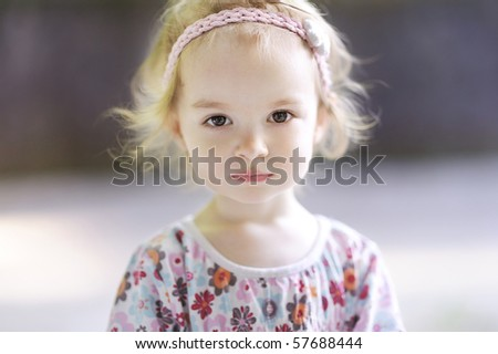 stock photo : Adorable toddler girl looking at the camera