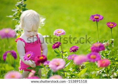 Adorable toddler girl portrait outdoors at summer