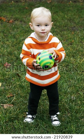adorable toddler holding ball