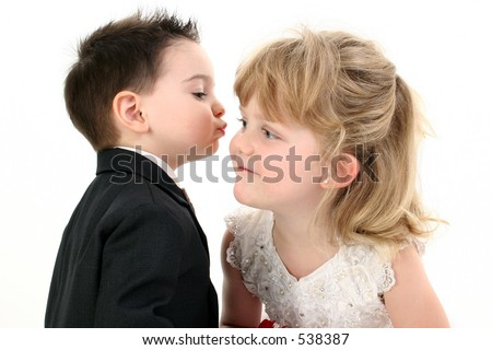 Adorable Two Year Old Boy Puckered Up To Give His Girl A Kiss. Shot in studio over white.