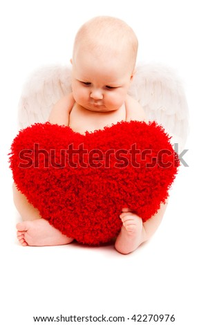 Adorable valentine baby angel looking at heart