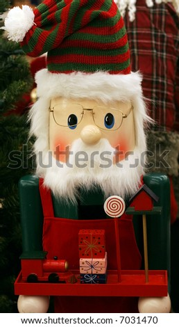 adorable wooden elf holding tray with toys