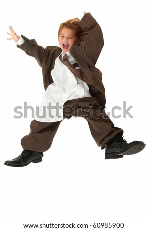Adorable 5 year old american girl in baggy over sized business suit falling over white background.
