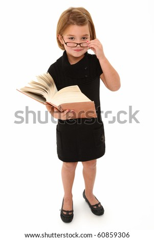 Adorable 7 year old american girl with glasses and very large book over white background.