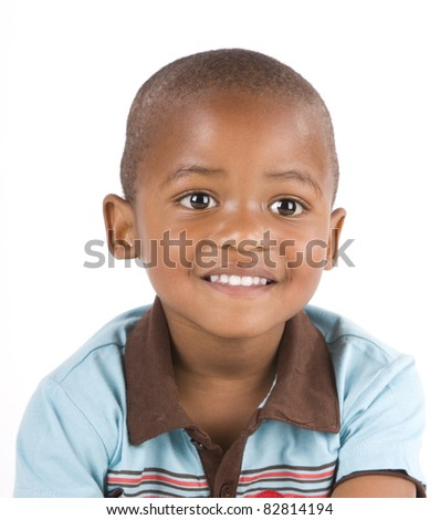 Adorable 3 year old black or African American boy smiling - stock photo