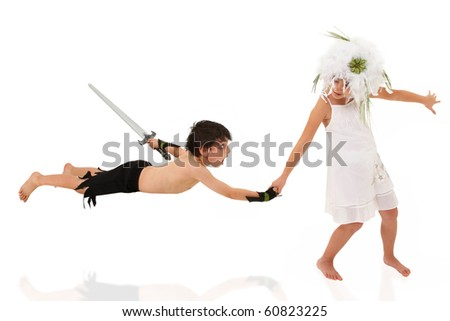 Adorable 7 year old boy and girl playing princess and warrior over white.  Girl pulling warrior to her rescue.