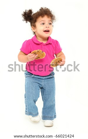 Adorable 1 year old hispanic african american girl running with cookies.