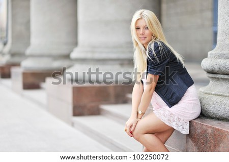 Adorable young beautiful pregnant girl looking at you. Copyspace image