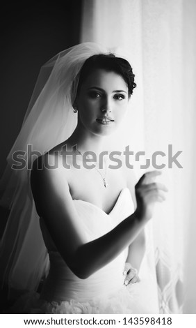 adorable young dark hair bride, getting ready in the morning, black and white portrait