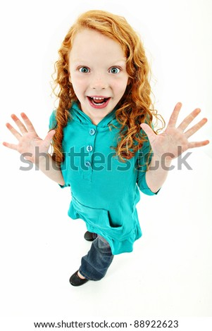 Adorable young girl standing over white background with excited expression.