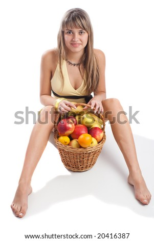 Adorable young lady sitting with fruit basket, isolated - stock photo