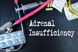 Adrenal insufficiency word, medical term word with medical concepts in blackboard and medical equipment.