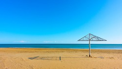 Adriatic sea and emply sandy beach with parasol in the morning, Rimini, Italy. Panoramic view