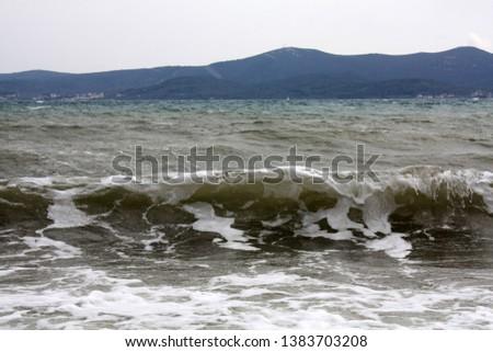 Adriatic Sea. Dalmatia. Landscape with waves and mountains on island.