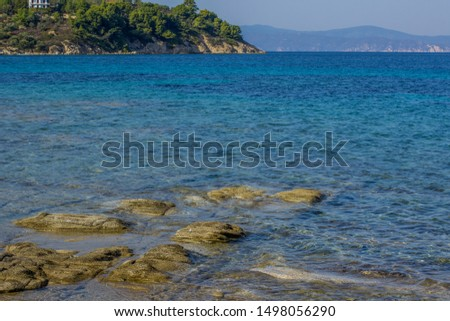Adriatic sea lagoon stone scenic landscape view shore line with water surface and main land background  #1498056290