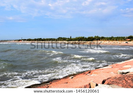 Adriatic Sea view at Rosolina Mare, Italy. Sea waves reaching the beach against blue sky.  #1456120061