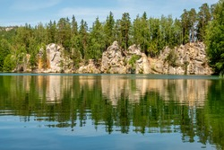 Adrspach Pond. Adrspach-Teplice Rocks are an unusual set of sandstone formations in northeastern Bohemia, Czech Republic. They are named after two municipalities: Adrspach, and Teplice nad Metuji.